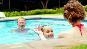 Family enjoying in swimming pool