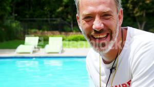 Happy lifeguard at pool side