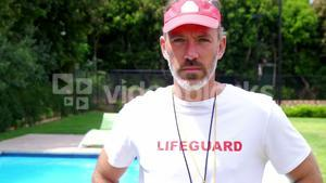 Lifeguard standing at pool side