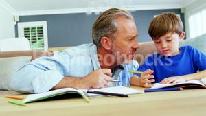 Father helping boy with homework