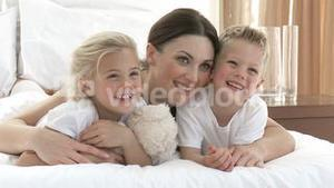 Mother, daughter and son together in bed