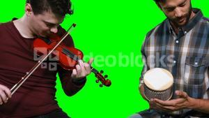 Male musicians playing violin and cabasa