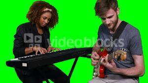 Musicians playing piano and guitar