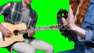 Musicians playing guitar and tambourine