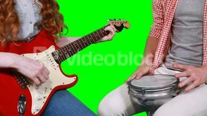 Mid section of musicians playing guitar and drum