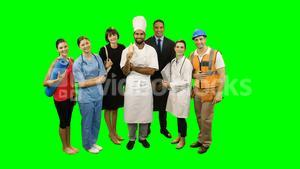 Various professional standing against green screen