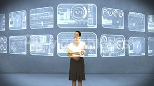 Businesswoman using digital interface screen