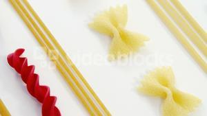 Farfalle spaghetti green and red pasta aligned arranged on white background