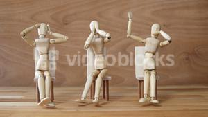 Wooden figurines embody the proverbial principle of see no evil, speak no evil, hear no evil on wood