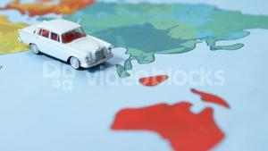Miniature car on a map