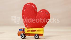 Red heart being carried by truck