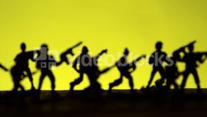 Silhouette of soldiers with rifle
