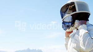Beekeeper wearing protective mask in apiary