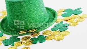 Leprechauns gold and hat with shamrocks on white background for st patricks