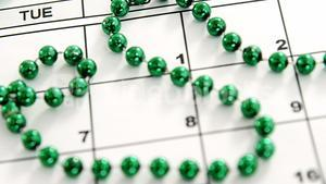 Close up view of green accessories on calendar for st patricks day