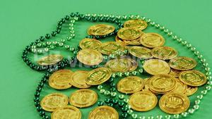 Leprechauns gold and green necklace on green background for st patricks