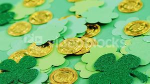 Green shamrocks and leprechauns gold on green background for st patricks