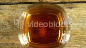 Bird view glass of whiskey on wooden table for st patricks