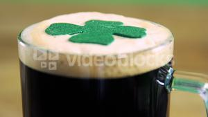 Close up view of head of a pint with shamerock for st patricks day