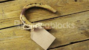 Horse shoe and tag on wooden background for st patricks
