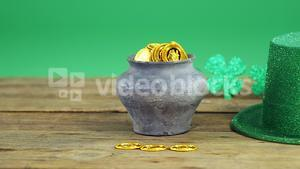 Leprechauns pot of gold and hat on table for st patricks