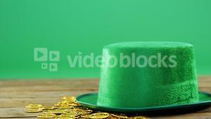 Leprechauns hat and gold on table for st patricks