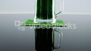 Green pint of beer on table for st patricks