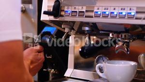 Barista making coffee with coffee maker