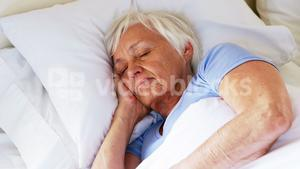 Senior woman sleeping in the bedroom