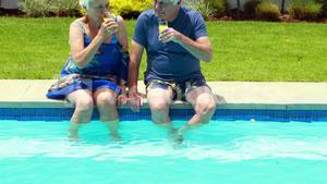 Senior couple interacting with each other while having juice