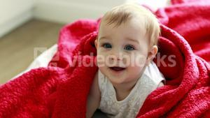 Cute baby girl on bed in bedroom