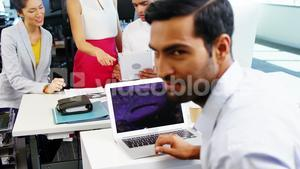 Executive using laptop in office