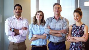 Executives standing with arms crossed