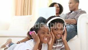 AfroAmerican children listening to the music at home