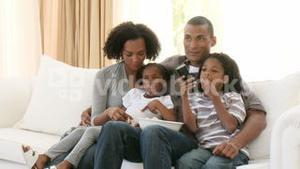 AfroAmerican family watching television