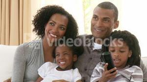 Close up of AfroAmerican family watching television