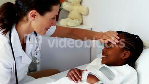 Female doctor examining a sick girl