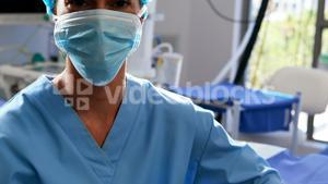 Female nurse in surgical mask at operation theater