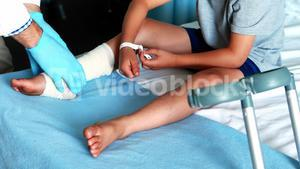 Male doctor examining patient leg