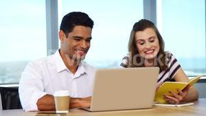 Happy executives using laptop