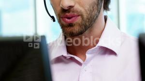 Male customer service executive working at his desk