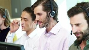 Team of customer service executives working at desk