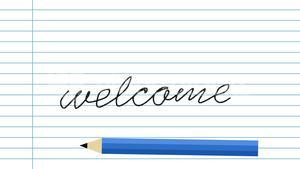 Pencil writing welcome text on paper