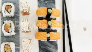 Set of assorted sushi served on gray stone slate