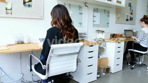 Business executive using digital tablet in office