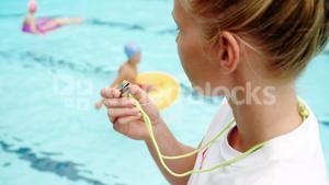 Swim coach blowing whistle
