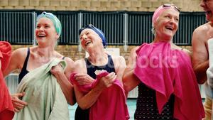 Seniors wiping their body with towels after swimming