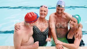Portrait of seniors interacting in swimming pool