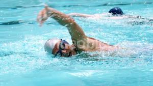 Senior man swimming in pool