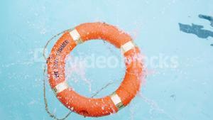 Inflatable ring floating in swimming pool